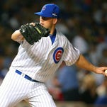 Chicago Cubs relief pitcher Clayton Richard pitches the fifth inning against the New York Mets in game three of the NLCS at Wrigley Field.