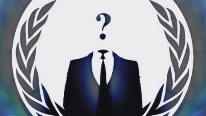 A screen shot from a video posted on YouTube by individuals identifying themselves as the hacktivist group Anonymous.