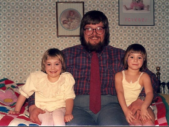 Abbey, her dad Jeff and twin sister Sarah at about