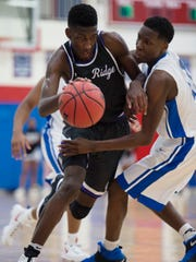 Cane Ridge's Damion Baugh (2) is fouled by Antioch's