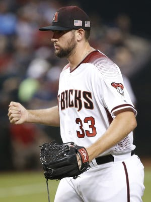 Diamondbacks' Jake Barrett (33) reacts after allowing a three-run home run against Nolan Arenado in the eighth inning at Chase Field in Phoenix, Ariz. on Sept 11, 2017.