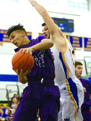 A Boiling Springs player pulls down a rebound against