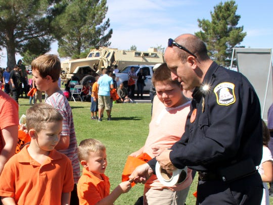 Deming Police Chief Bobby Orosco handed out badges
