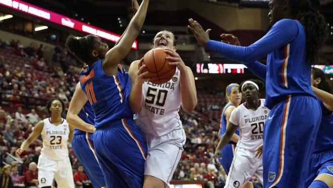 FSU's Chatrice White fights to get the ball up against Florida's Dyandria Anderson during the Seminoles' 83-58 win over the Gators.