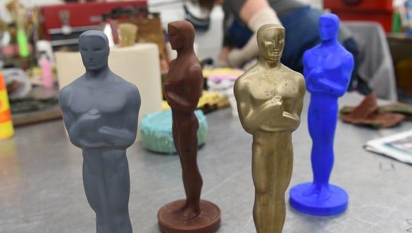 Four versions of an Oscar at Polich Tallix Fine Art