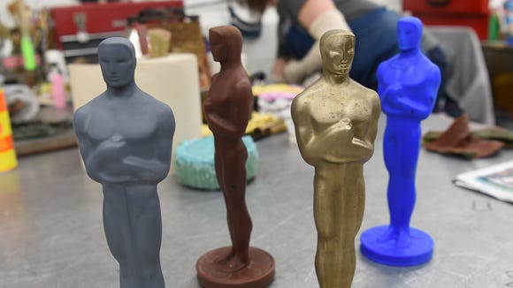 Four versions of an Oscar at Polich Tallix Fine Art Foundry in Orange County, which crafted the statuettes for Sunday's Academy Awards. The four different materials are, from left, ceramic, wax, bronze, and 3D printed wax.
