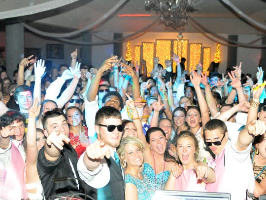 Port Clinton High School students dance the night away at their 2015 Prom at Caesar's Crystal Palace in Sandusky on Saturday night.