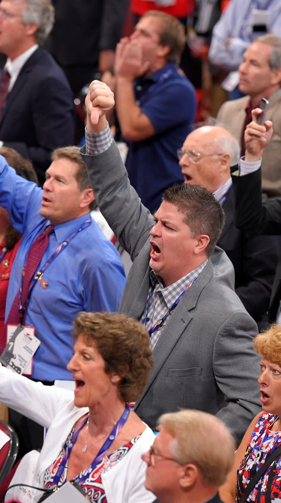 Delegates react as some delegates call for a roll call