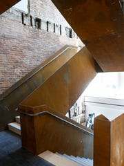 The new metal staircase inside at the Kentucky Museum of Art and Craft ties in to the museum's goals to be more transparent, making the staircase visible to pedestrians outside. June 29, 2016