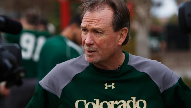 Colorado State interim head coach Dave Baldwin talks to the media after NCAA college football practice, Wednesday, Dec. 17, 2014 in Las Vegas. Baldwin was named to Ed McCaffrey's staff at Northern Colorado this week.