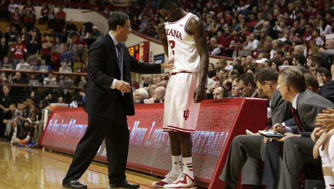 Indiana coach Tom Crean works with forward Hanner Mosquera-Perea (12) on the bench during a NCAA men's basketball game on Saturday, Dec. 6, 2014, at Assembly Hall in Bloomington. (James Brosher / For The Star)