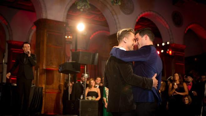 JC Chasez serenades Lance Bass and Michael Turchin during the wedding.