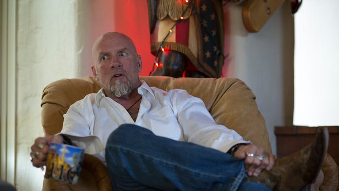 Former ATF agent Jay Dobyns talks about his undercover work, October 15, 2014, from the den of his Tucson home.
