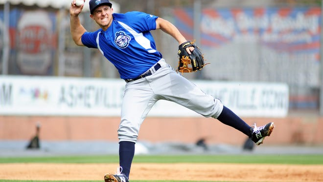 Asheville Tourists infielder Kevin Padlo throws to first during practice drills Wednesday April 8, 2015.