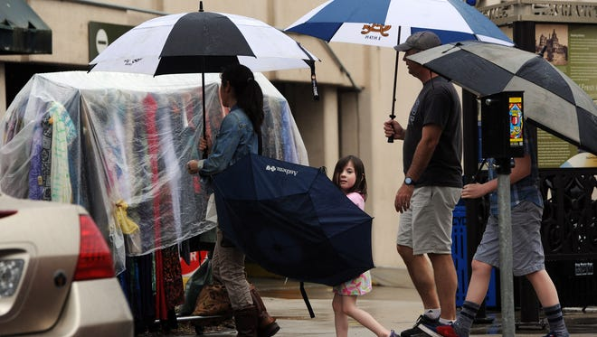 Both patrons and merchandise were under cover on April 7 as heavy rain fell over the area.