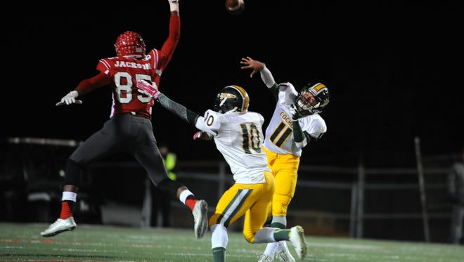 Reynolds senior Tevin Stafford throws a pass during a 2014 game against Erwin.