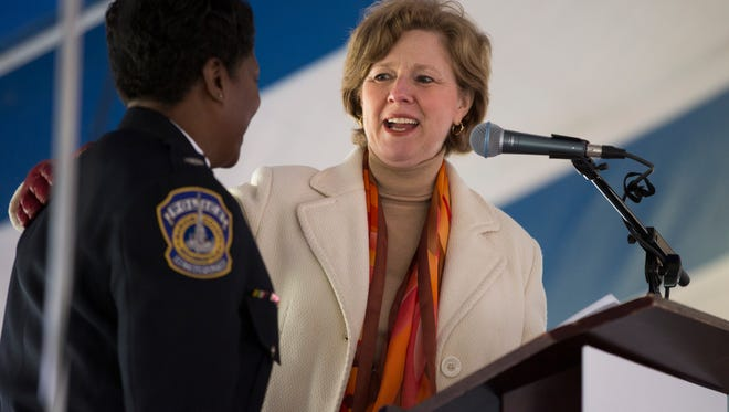 U.S. Rep. Susan Brooks, R-Ind., on April 4, 2015, recognizes Indianapolis Metropolitan Police Department Commander Karen Arnett during a commemoration ceremony for the Kennedy King Memorial Initiative at Martin Luther King Memorial Park in Indianapolis.
