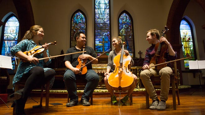From left to right, musicians Jinjoo Cho, Eric Wong, Madeline Fayette and Fitz Gary sit for a portrait at Trinity Episcopal Church before their free concert benefiting the Blue Ridge Area Food Bank in Staunton on April 22, 2015.