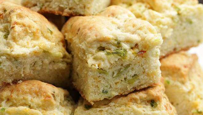 Generous bits of Hatch green chiles give heat and smoky flavor to the biscuits at Sierra Bonita Grill in Phoenix.