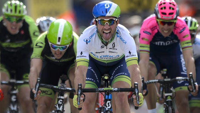 New overall leader Swiss Michael Albasini (Orica GreenEdge) shows his tongue after winning the second stage at the Tour de Romandie on April 29 in Saint-Imier, western Switzerland.