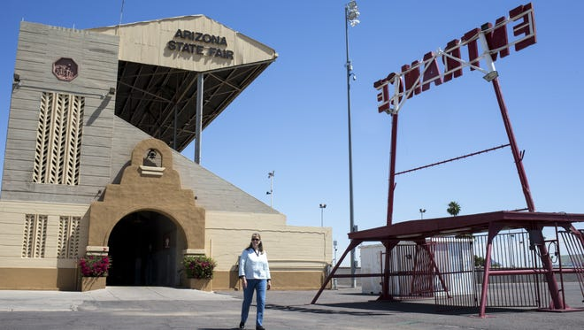 Lauren Allsopp, a faculty associate at Arizona State University, walks by the  Grandstand Arena.