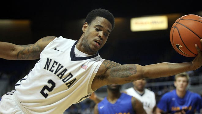 Tyron Criswell reaches for a loose ball during a game against San Jose State last season.
