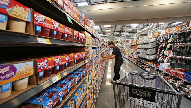 An aisle of snack foods in the about-to-open WinCo Foods in Surprise on June 24, 2015.