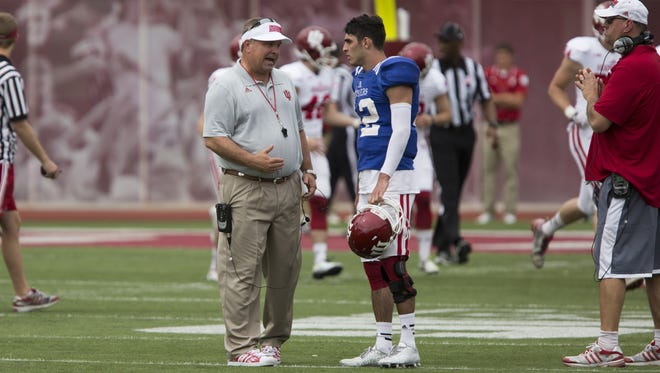Indiana coach Kevin Wilson, left, talks with quarterback Zander Diamont during the Cream and Crimson Spring Game on Saturday, April 18, 2015, at Memorial Stadium in Bloomington.