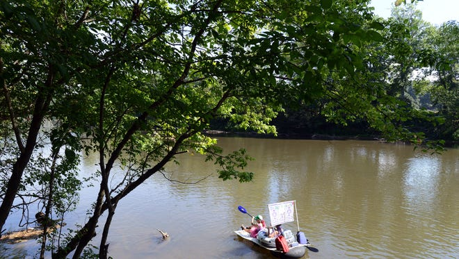 """Dozens of boats and hundreds of spectators watched the launching of custom-made boats at Hominy River Park Saturday morning. The """"anything that floats"""" boat race was comprised of boats decorated with a theme, and were paraded down the French Board River past the River Fest celebration at French Board Park off Amboy Road."""