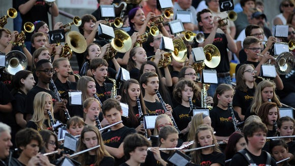The Asheville High band plays during Friday's Asheville-Franklin football game.