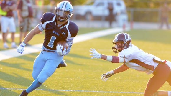 Michael Cantrell (1) rushed for 308 yards and five touchdowns on Friday.