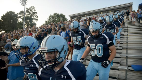Enka football players enter the field prior to last Friday's home win over Owen.