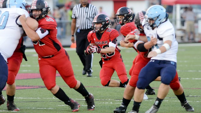 Pisgah's Daniel Van Vaerenbergh carries the ball against Enka on Friday in Canton.