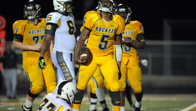 Reynolds senior Rico Dowdle (5) and the Rockets won 43-15 over previously-unbeaten Watauga on Friday in Boone.
