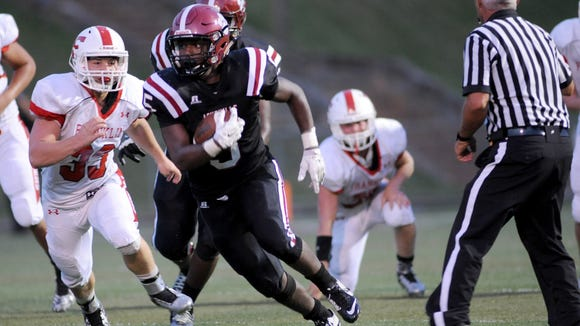 Reggie Battle, shown here in an Aug. 21 game with Franklin, ran for 181 yards Thursday night at Winston-Salem Carver.
