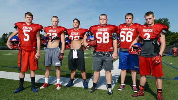 Madison football players, from left to right, Colby Edwards, Mason Edwards, Travis Hollifield, Brent Turner, Brason Payne and Junior Denton.
