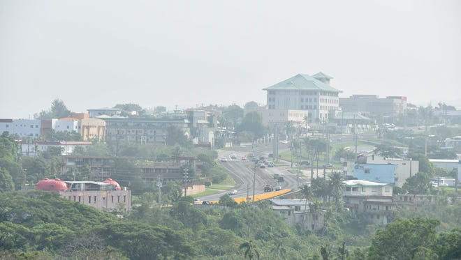 The view of Maite from Hagatna was shrouded Monday morning.