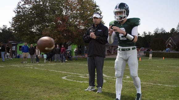 Christ School quarterback Drew Johnson and Greenies assistant coach Heath Shuler.