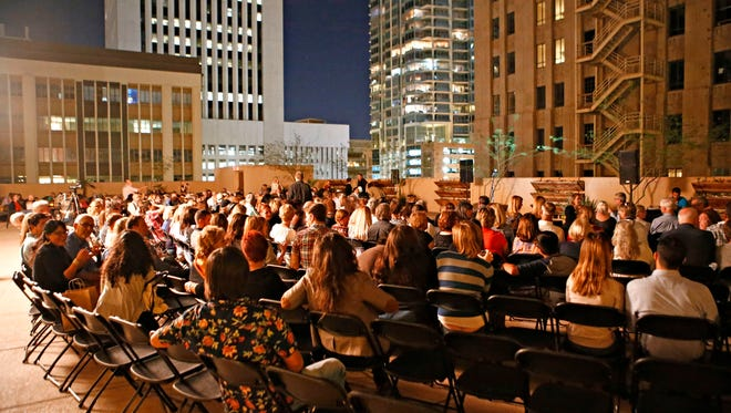A crowd gathers for Storytellers on the roof top terrace of the Renaissance Hotel in downtown Phoenix  on October 26, 2015.