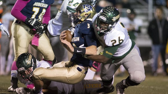 Reynolds' Malik Long (26) tackles Roberson quarterback