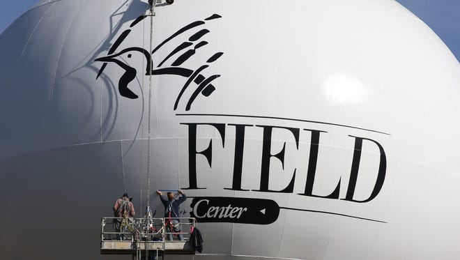 Workers paint the new water tower in Marshfield, set to be operational next week.
