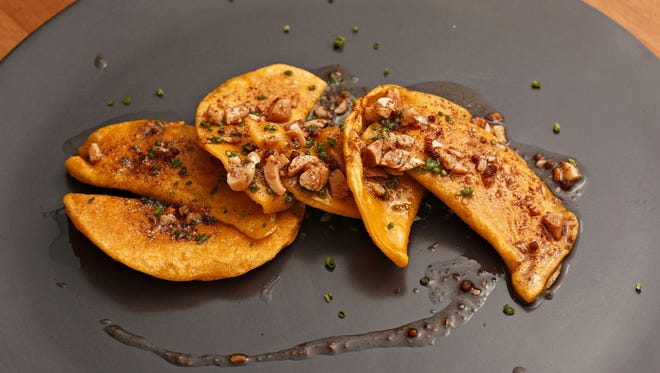 Donald Hawk's Sweet potato pierogi with fish sauce, brown butter, Marcona almonds and lime at the Crepe Bar in Tempe.