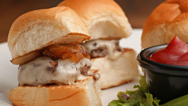 The sliders from The Watershed in Tempe come in an order of three and feature Arizona-grown beef, sweet grilled onions and Swiss cheese on mini Hawaiian-style sweet rolls.