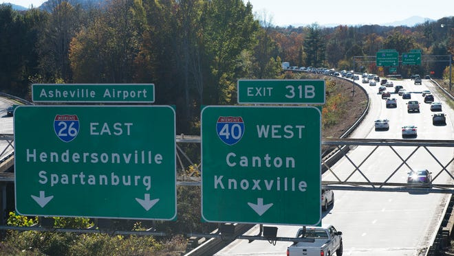 Traffic begins to slow at the western end of Interstate 240, where it intersects Interstate 26 and Interstate 40 on the west side of Asheville, during rush hour on a recent Friday.