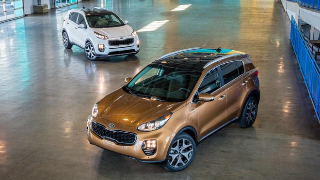 Kia unveils new 2017 Sportage, shown here with regular and all-wheel drive, at 2015 Los Angeles Auto Show