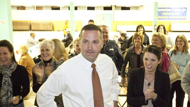 In this 2012 file photo, District 38 House seat winner Denny Butler awaited results during a post election rally.