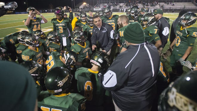 Reynolds coach Shane Laws addresses his team before overtime Friday night.