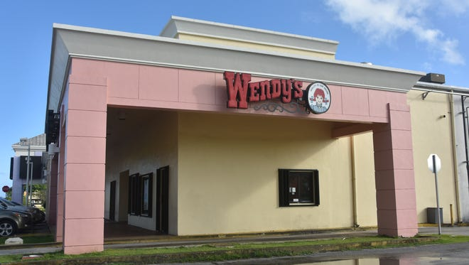 A black-clad gunman attempted to rob the Hagatna Wendy's by approaching the drive-through window Tuesday morning, according to employees.
