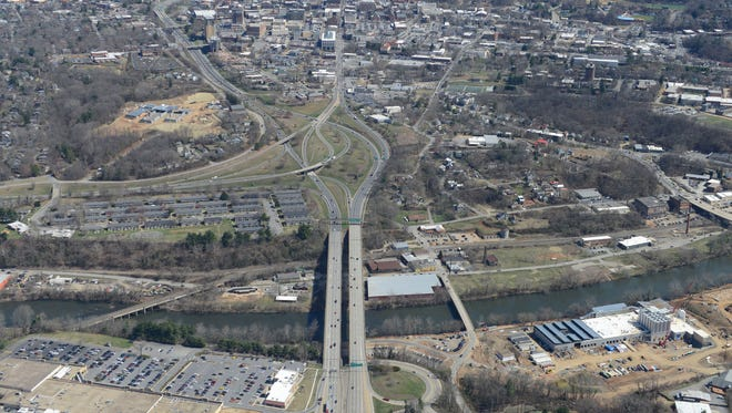 In this aerial photo, traffic flows over the Captain Jeff Bowen Bridge connecting east and west Asheville.