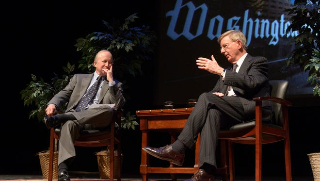 Washington Post columnist George Will, right, discusses politics and society with Purdue President Mitch Daniels on Monday at Loeb Playhouse. During the Presidential Lecture Series event, Will was critical of universities and their commitment to diversity over free speech and unfettered academia.